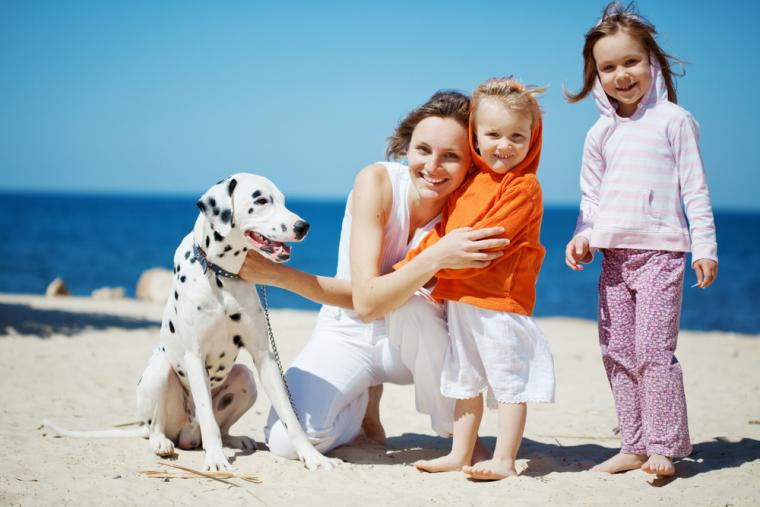 Family on vacation with dog